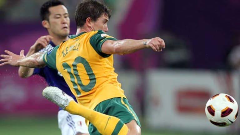 Harry Kewell strikes the ball towards goal.