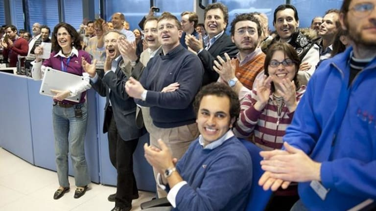 Physicist Fabiola Gianotti (far left) and her team celebrate the identification of the Higgs Boson in the Large Hadron Collider, in the documentary <i>Particle Fever</i>.