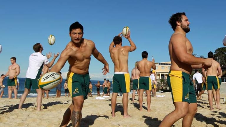 Beach ball … Wallabies players at a recovery session in Coogee yesterday, following their humiliating loss to Samoa on Sunday.