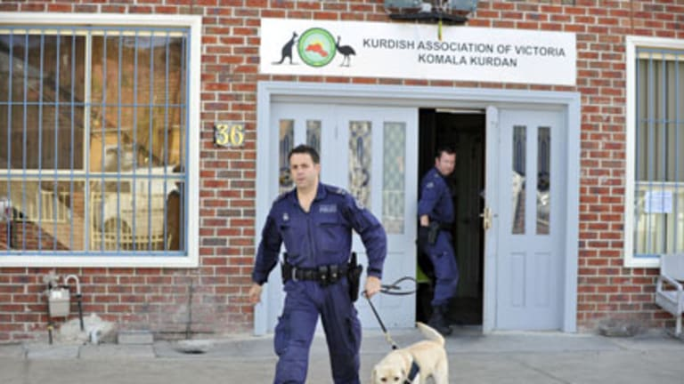 AFP officers raid the Kurdish Association of Victoria in Pascoe Vale yesterday.