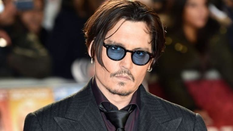 US actor Johnny Depp arrives for the UK premiere of the film <i>Mortdecai</i> in London on January 19, 2015.