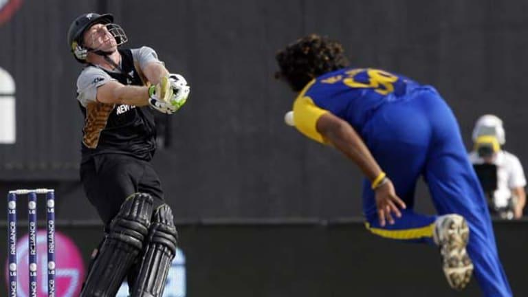 Scott Styris plays pulls a shot off Sri Lanka's Lasith Malinga's bowling.