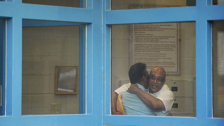 Andre Davis, right, is hugs his father Richard Davis inside the Tamms Correctional Centre.