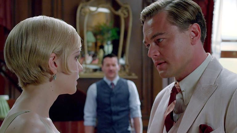 Tom Buchanan (Joel Edgerton, centre) and Jay Gatsby (Leonardo Di Caprio) are suavely attired in The Great Gatsby.