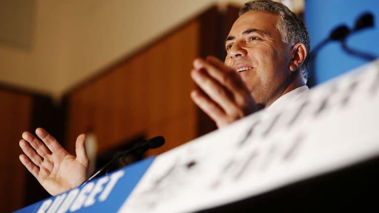 Agencies to consolidate: Treasurer Joe Hockey speaks to the media in the budget lockup.