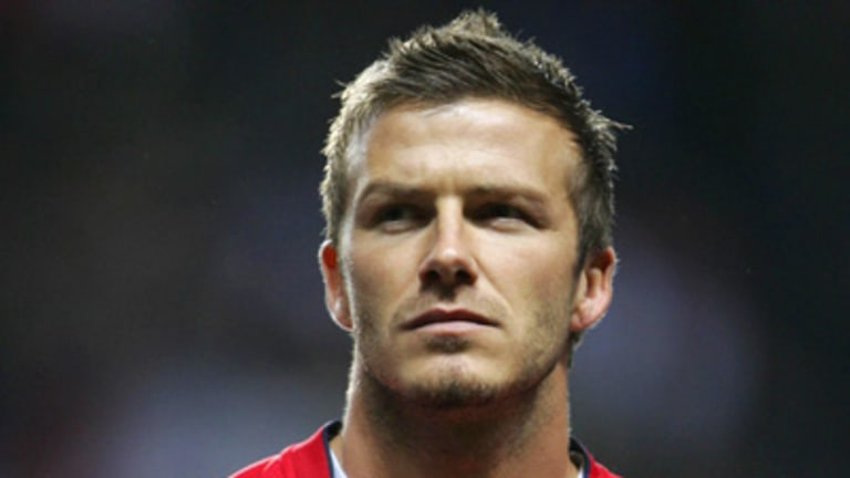 David Beckham's management will take legal action against a magazine which claimed the football star used prostitutes.