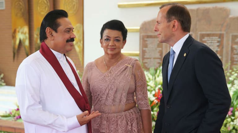 Prime Minister Tony Abbott speaks with Sri Lankan President Mahinda Rajapaksa. Australia has returned 41 asylum seekers to Sri Lankan custody despite Australia accusing the country of state-sponsored torture.