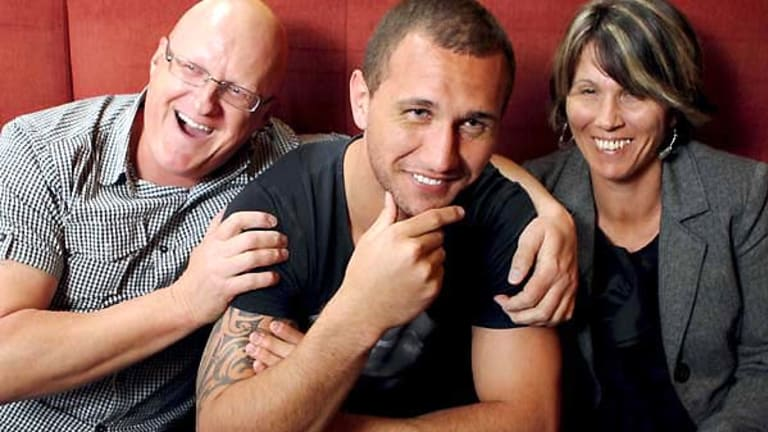 Wallaby pride ... Quade Cooper, centre, with his stepfather David Jones and mother Ruhia Jones.