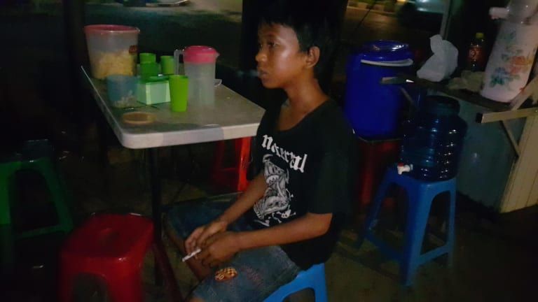Sandi Saputra, a 13 year old smoker from Palembang.