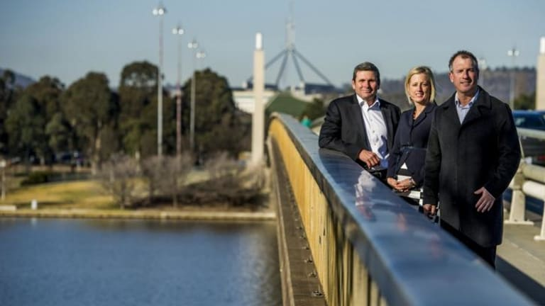 Authors and journalists Chris Uhlmann and Steve Lewis with Chief Minister Katy Gallagher on Commonwealth Bridge where a mini-series based on their books will be shot.