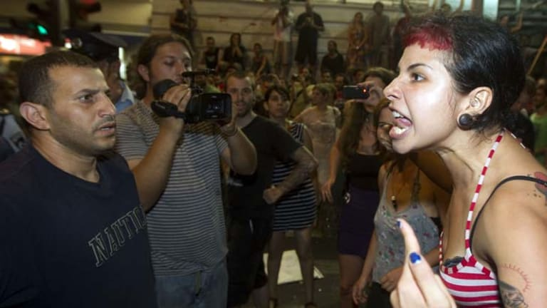 Read my lips … protesters confront police in Tel Aviv as protests about the high cost of living spread.