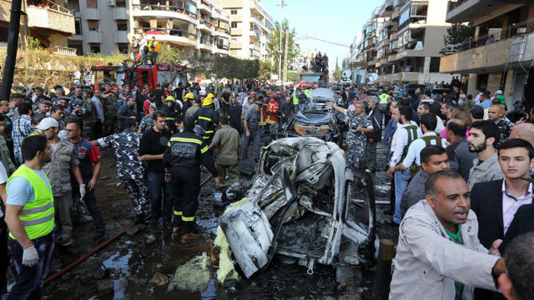 Widespread damage: People gather at the scene where two explosions struck near the Iranian embassy.