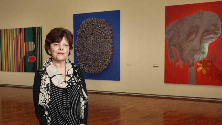 National Gallery of Australia senior curator Deborah Hart with some of the works by Australian painter Dale Frank.