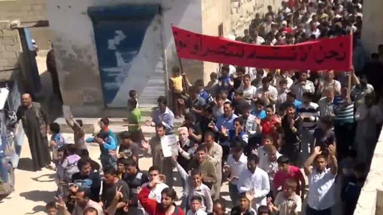 Emboldened ... anti-regime protesters march through the town of Al-Tah, in Idlib province, after the ceasefire went into effect.