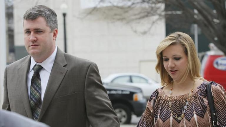 Watson and his wife Kim outside court in Alabama, his home town.
