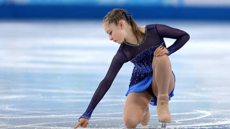 The teenage Russian started her routine by drawing a heart on the ice.
