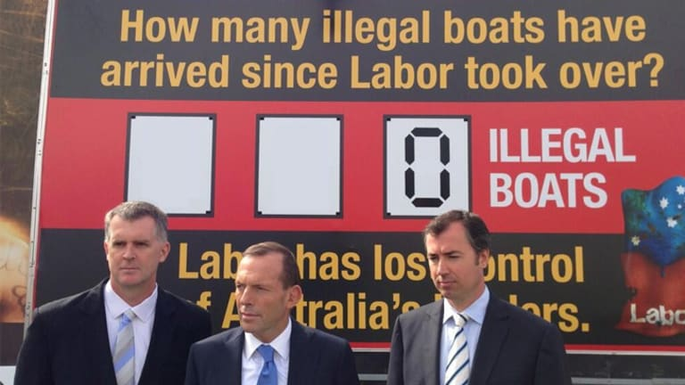 Tony Abbott's illegal boats sign with some adjustments from Twitter user @plmcky.