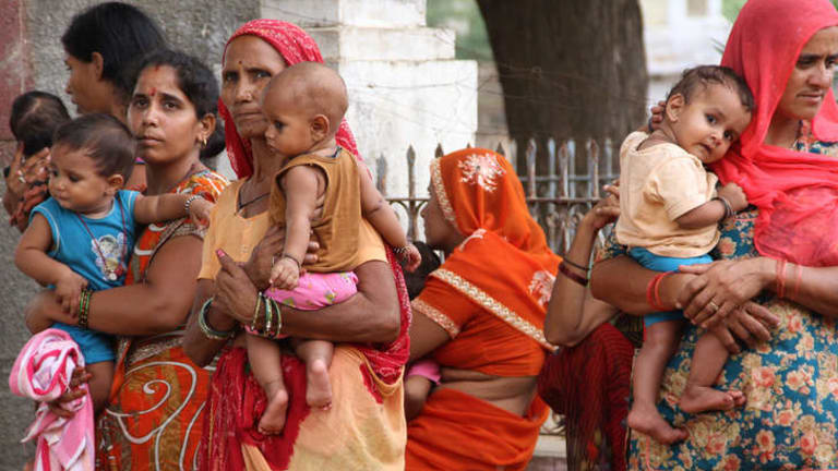 Complex issue: Mothers and their mothers-in-law wait at a sterilisation clinic in India. Photo: BEN DOHERTY