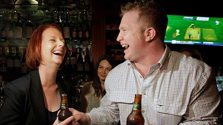 """The Australian's publican Matt Astill - sharing a laugh with Julia Gillard in March - says Aussie tourists and locals with """"nothing else to do"""" were propped at the bar."""