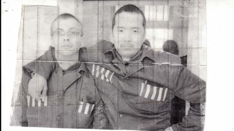 """""""I was scared out of my mind"""" … Troy Bremer (at left) with a fellow inmate, Mongolian Batar Batuka, at Beijing's Municipal prison No 2."""