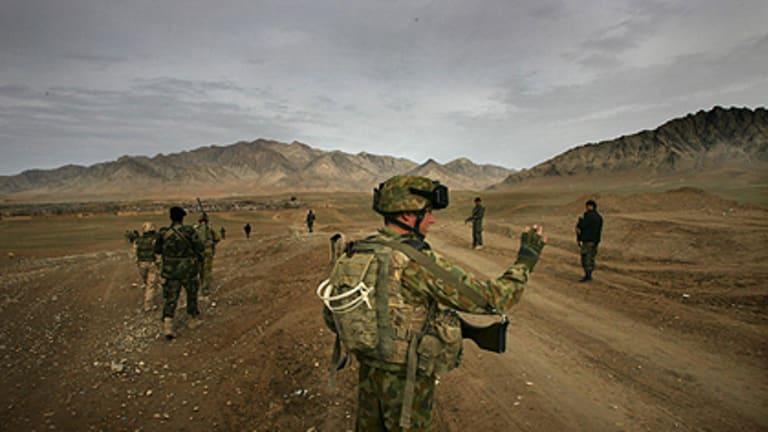 Australian soldiers on patrol in Afghanistan. The Australian Federal Police is sending members to train Afghans.