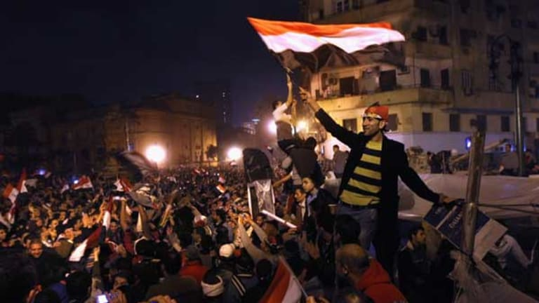 Egyptians celebrate in Tahrir Square after hearing the news that Hosni Mubarak had resigned.
