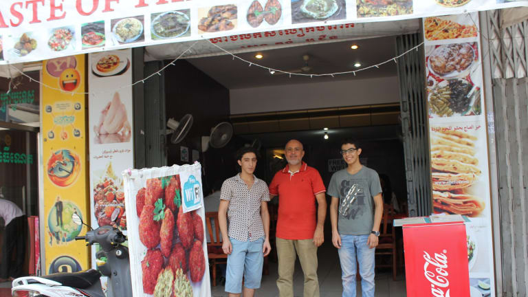 Hashim Farhan, 51, with his sons, Emad, 18, right, and Jassir, 22 at their restaurant in Phnom Penh.