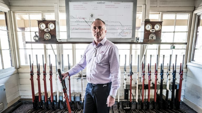 Kilmore East station master Colin Mans with the double line block signalling system.