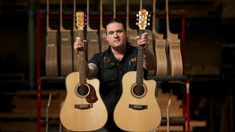 Guitar maker Andy Allen, with two guitars - one has a rosewood fretboard (pictured right) and the other a native mulga fretboard.