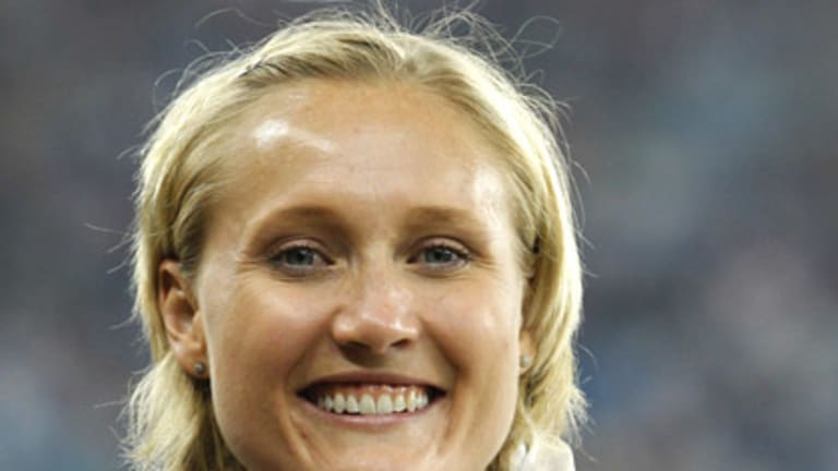Andrea Miller of New Zealand savours the moment after being awarded her bronze medal for the 100m hurdles.
