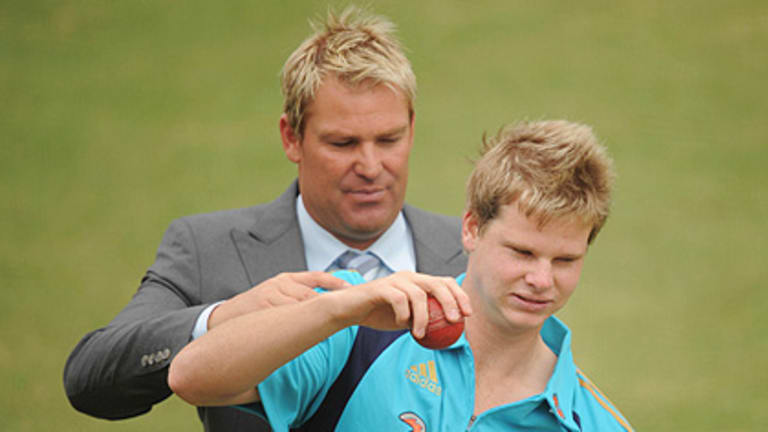 Mentor...Shane Warne gives Steven Smith some advice in the MCG nets yesterday.