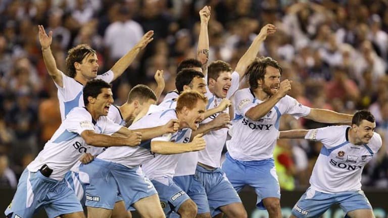 Winners ... Sydney FC players celebrate after winning the penalty shoot-out to claim the A-League grand final on March 20, 2010.