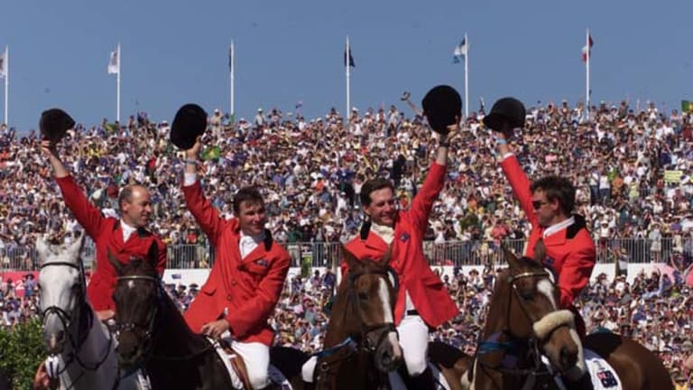 Stars of the show ... eventing team gold medalists Andrew Hoy, Phillip Dutton, Matt Ryan and Stuart Tinney at Sydney's Horsley Park in 2000.