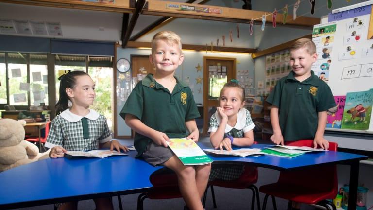 Glenorie Public School students Marlia Stewart, Knox Murray, Chloe Pratt and Cameron Trulove improve their reading skills.