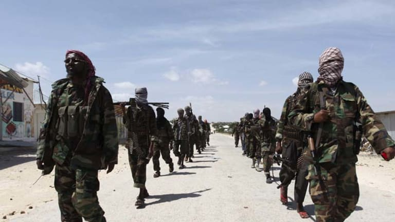 Al-Shabab soldiers on patrol in southern Mogadishu.