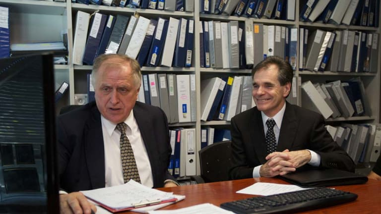 Queensland father Ron Williams (right) and his solicitor Claude Bilinsky react to the High Court ruling today.