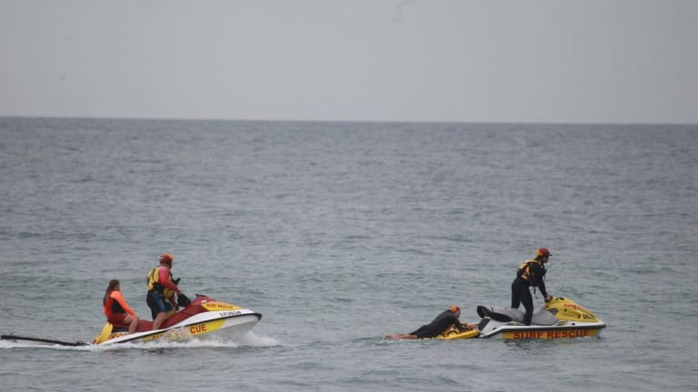 The search for the body of a missing man at Wybung Head on the central coast.
