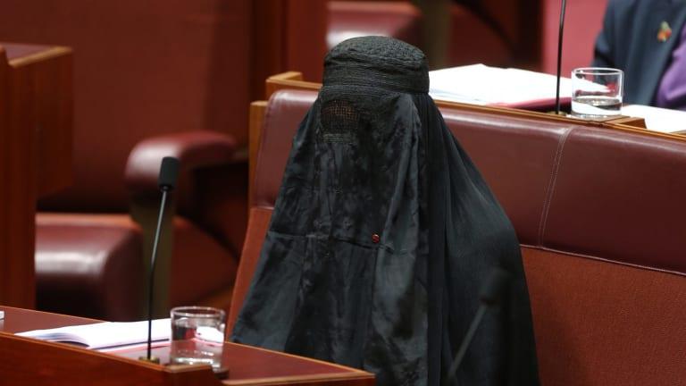 Senator Pauline Hanson wears a burqa in Parliament House.