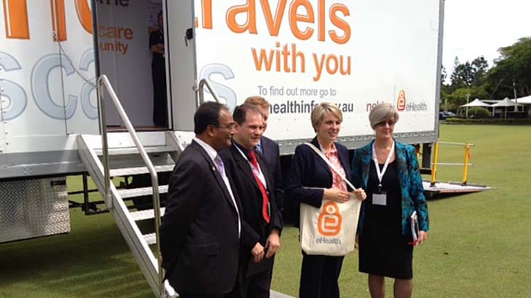 Minister for Health Tanya Plibersek (second from right) with NEHTA's Dr Mukesh Haikerwal, Dr Nathan Pinskier, Dr Chris Mitchell and CHIK Services CEO Sally Glass.