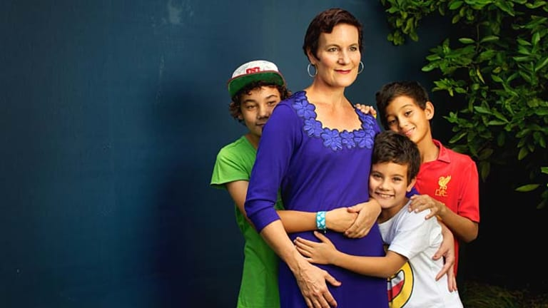 Still fighting on: Kirsty Sword-Gusmao with her sons Alex, Kay Olok and Daniel. ''A better deal in terms of the oil and gas reserves stands not just to benefit the East Timorese, but Australians as well.''