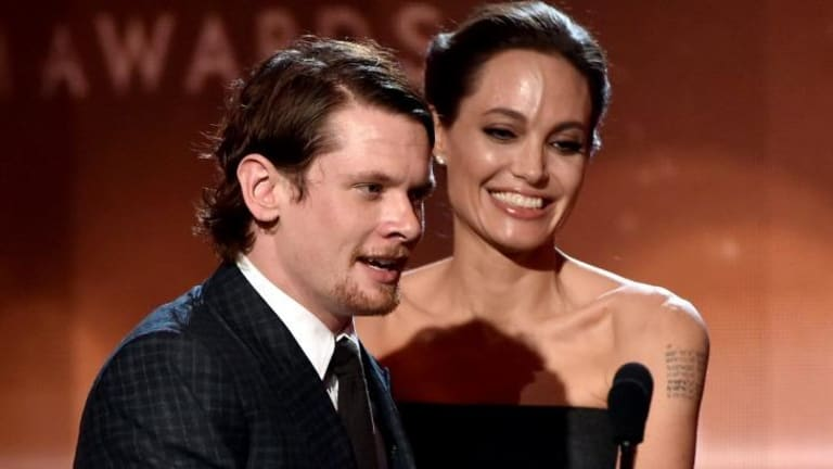 Jack O'Connell accepts the New Hollywood Award for <i>Unbroken</i> from actress Angelina Jolie