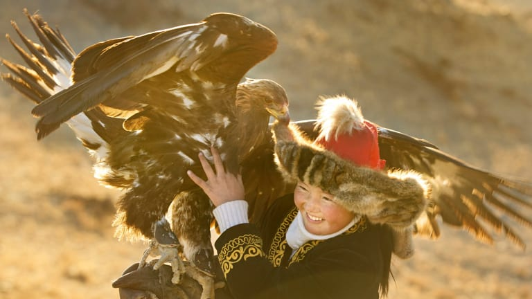 Aisholpan and her eagle.