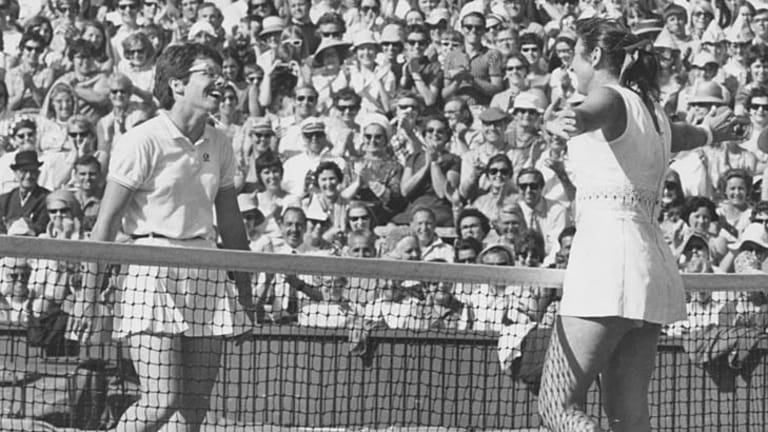 Judy Dalton, with her arms open wide, acknowledges her defeat by Billie Jean King in the Wimbledon women's singles quarter-finals in 1969.