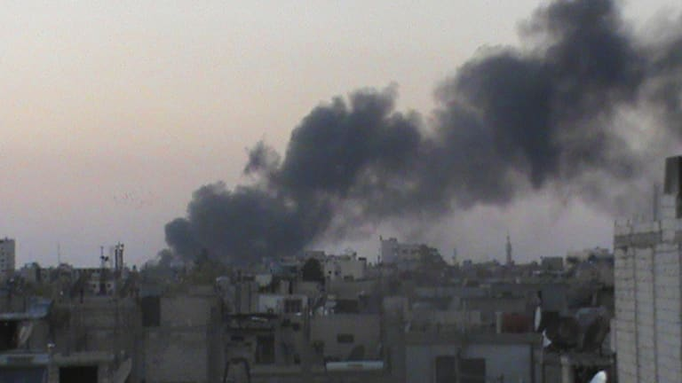 Smoke rises from Kerkenez near Idlib on July 6. Thousands of families in Syria have fled their homes in the past two weeks due to heavy fighting between government forces and rebels and many face food shortages.