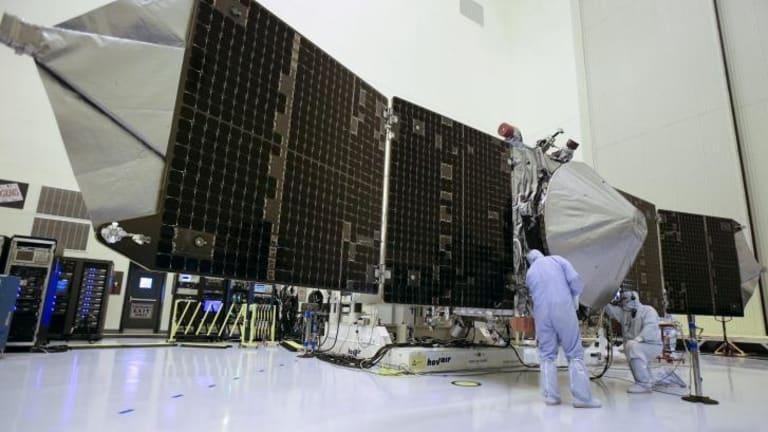 Technicians work on the MAVEN Mars orbiter last year.