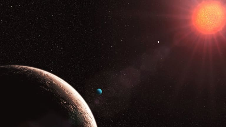 This illustration, released by the European Southern Observatory, shows the planet Gliese 581 e (blue), the lightest exoplanet discovered so far