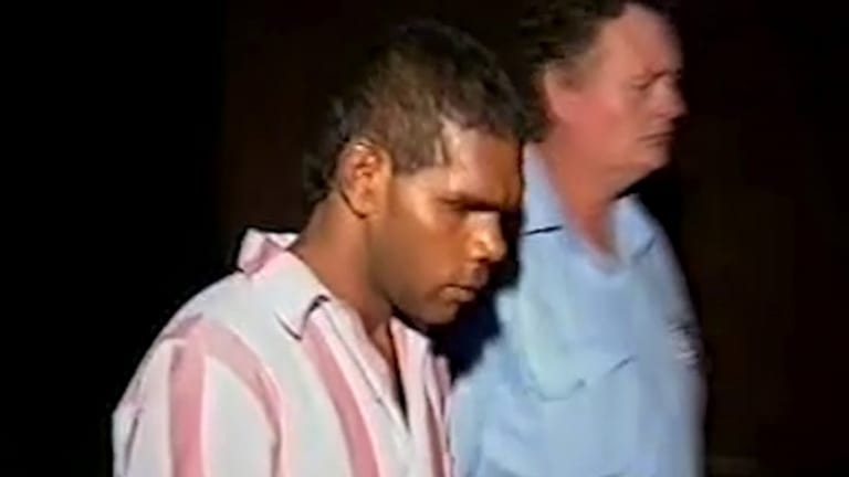 Kevin Henry, then 21, is led away by guards during his 1992 murder trial.