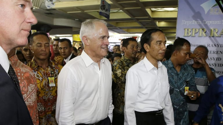 Prime Minister Malcolm Turnbull walks with Indonesian President Joko Widodo during their visit at Tanah Abang Market in Jakarta, Indonesia last month.