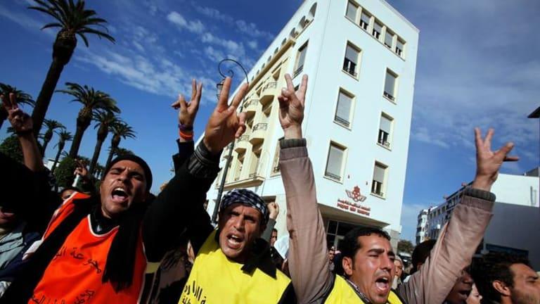 Unemployed graduates take part in a demonstration calling for a boycott of parliamentary elections, in Rabat.