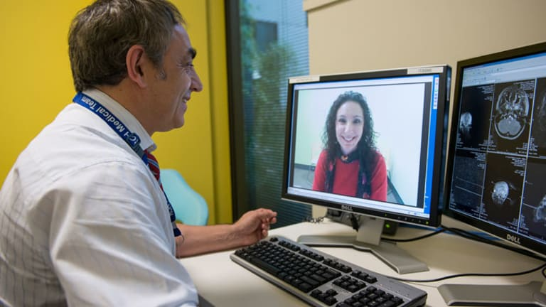 Professor Andrew Kornberg  from the Royal Children's Hospital in Melbourne, in a remote consultation with the mother of a young patient.